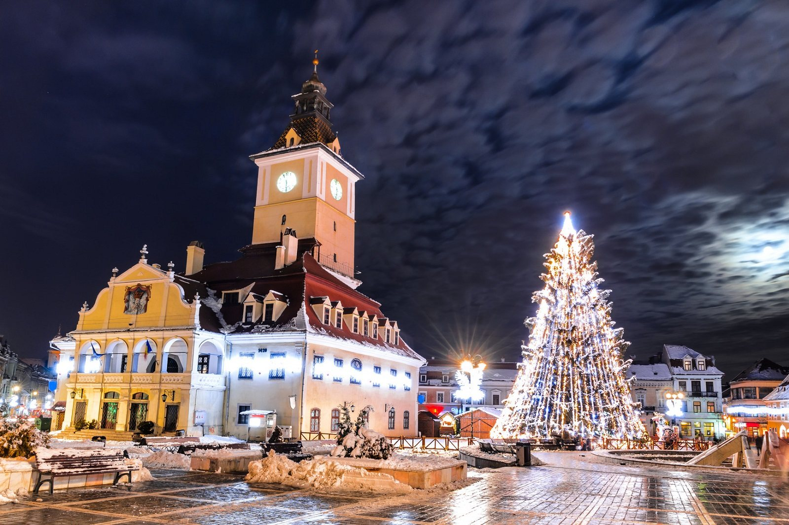 Brasov, Romania. Council Square and Xmas Tre. Historical medieval old city center square of Brasov in Christmas days.